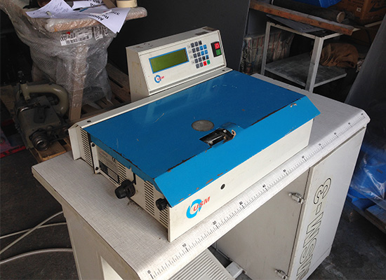 Photo of an Ellege GL12 industrial skiving machine Industrial Sewing Machines