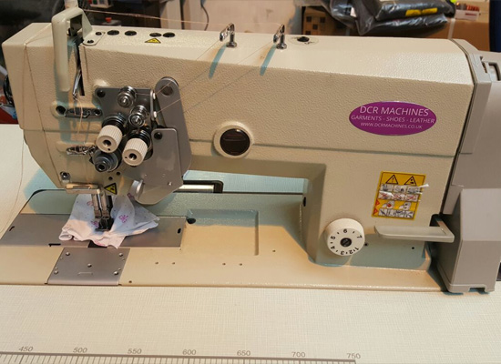 Photo of an DCR TNSB- Twin Needle Flat Bed Split Bar Sewing Machine Industrial Sewing Machines
