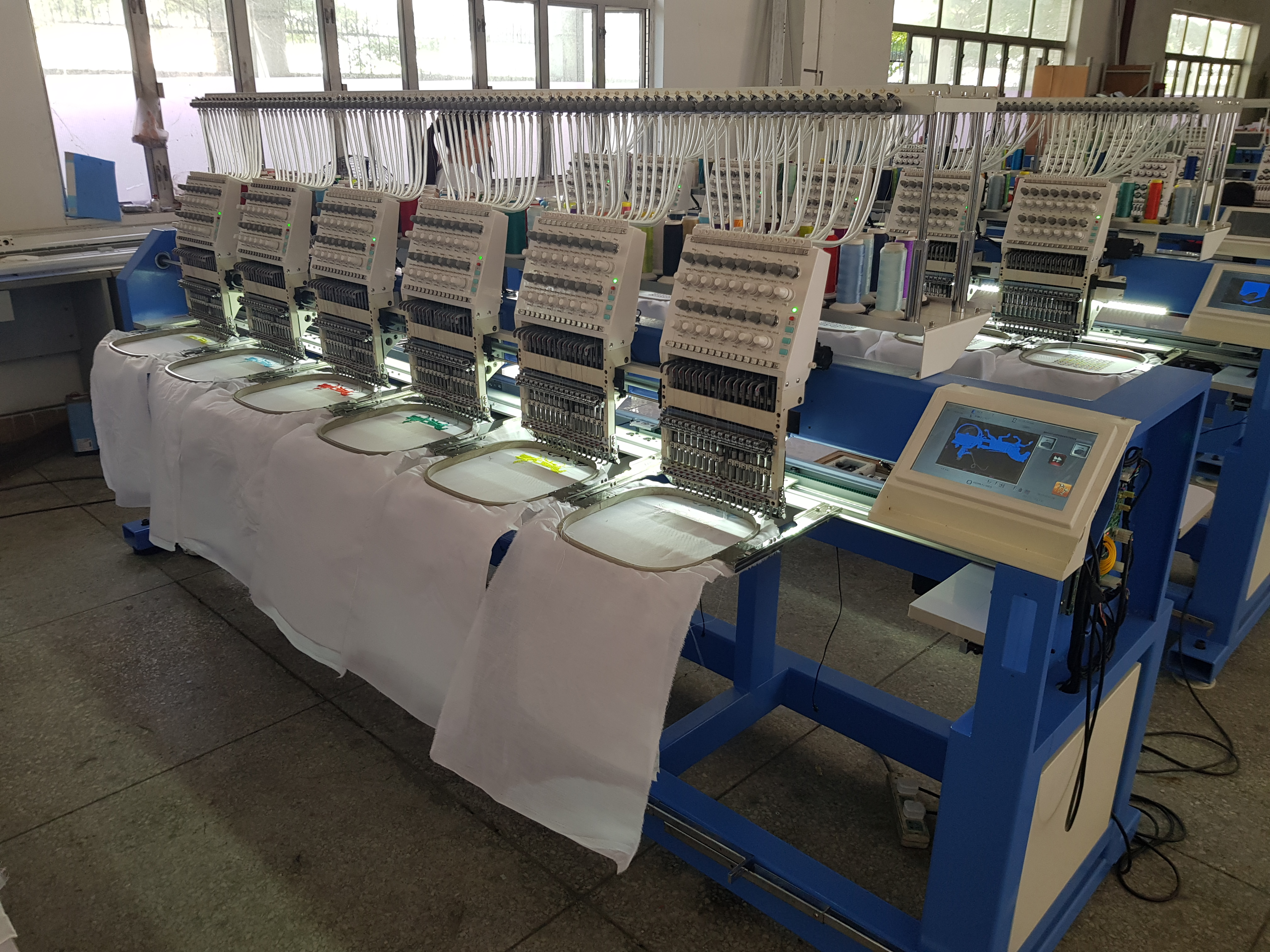 Photo of an DCR EMBR-6H-15N - 6 HEAD EMBROIDERY MACHINE 15 NEEDLE Industrial Sewing Machines