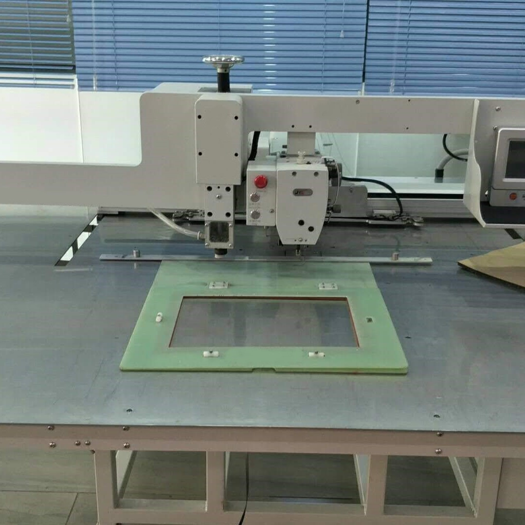 Photo of an DCR ASP68 Automatic Stitch & Punch sewing machine   Industrial Sewing Machines