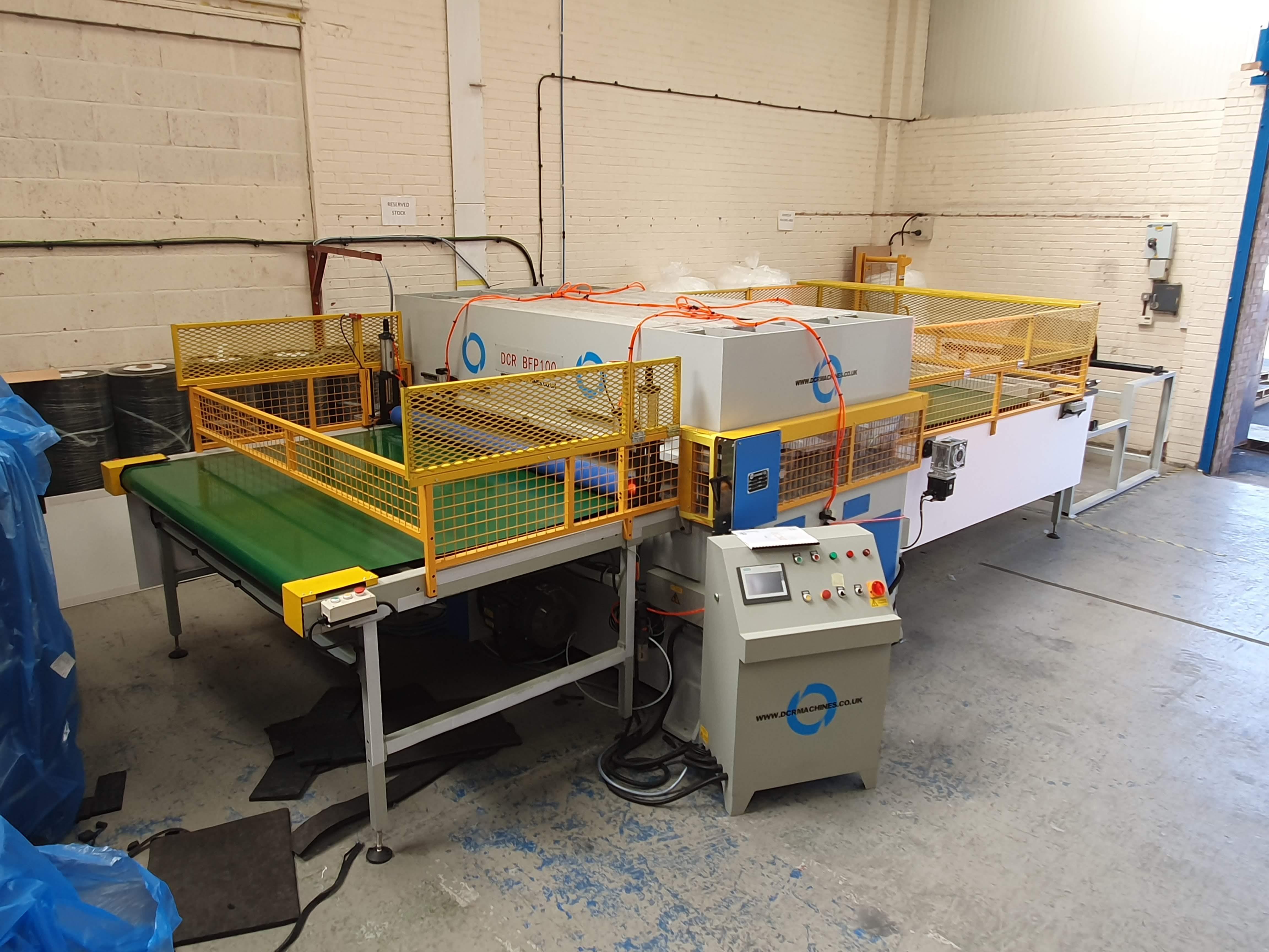 Photo of an DCR-BFP100 BELT FEED FULL BEAM PRESS 100T Industrial Sewing Machines